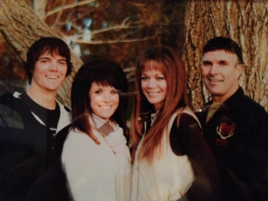 Joey Wood, his wife, Mollee, and their children, Mandy and Rylee